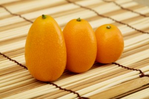 Fresh kumquat against a mat