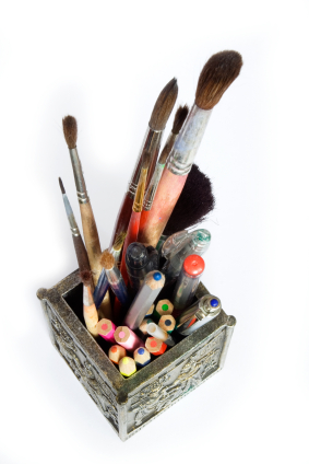 Cup with pens, pencils and brushes